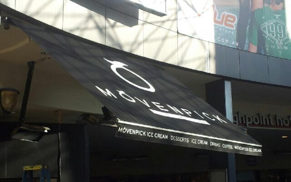 FOLDING ARM AWNING WITH SIGN WRITING