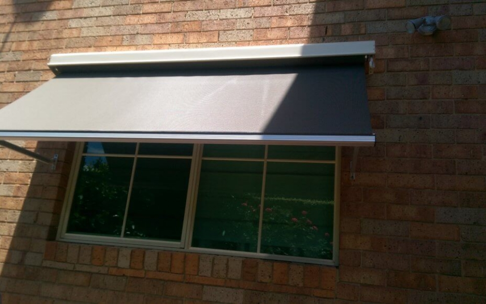 DROP ARM AWNING OVER WINDOW