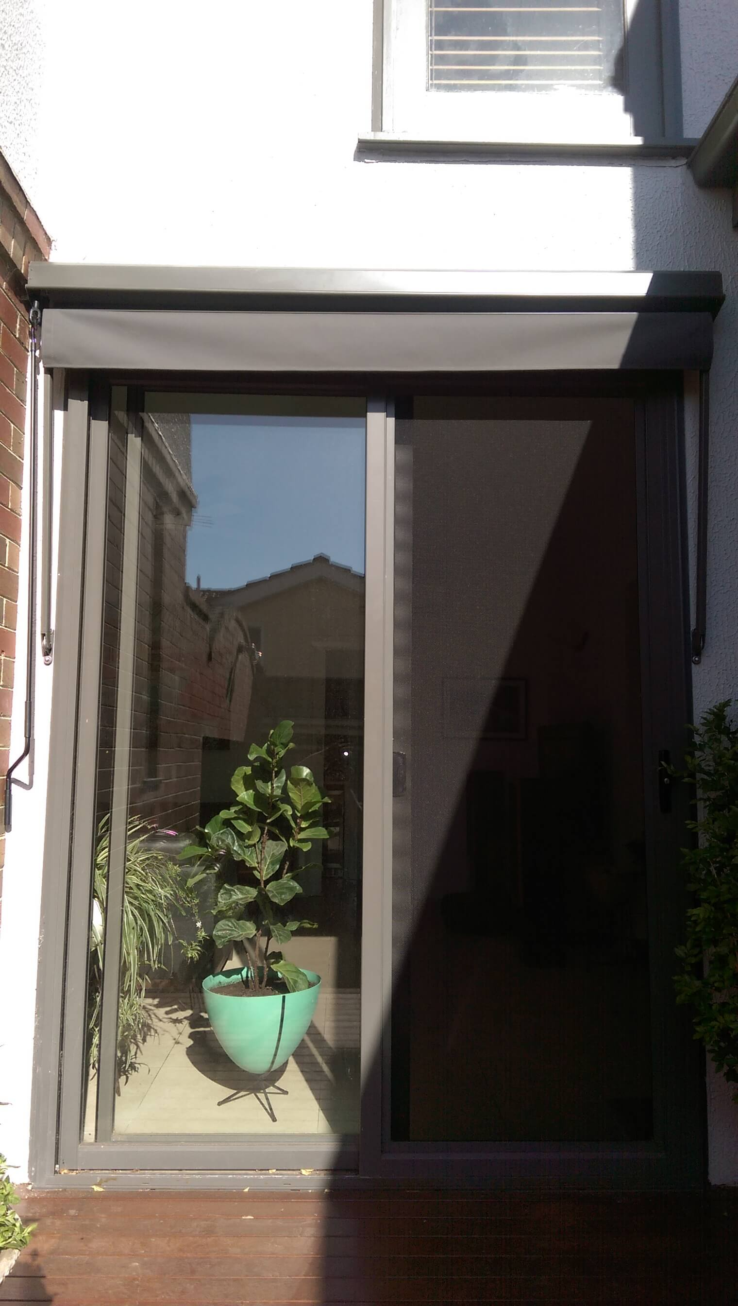 DROP ARM AWNING OVER DOOR OPEN